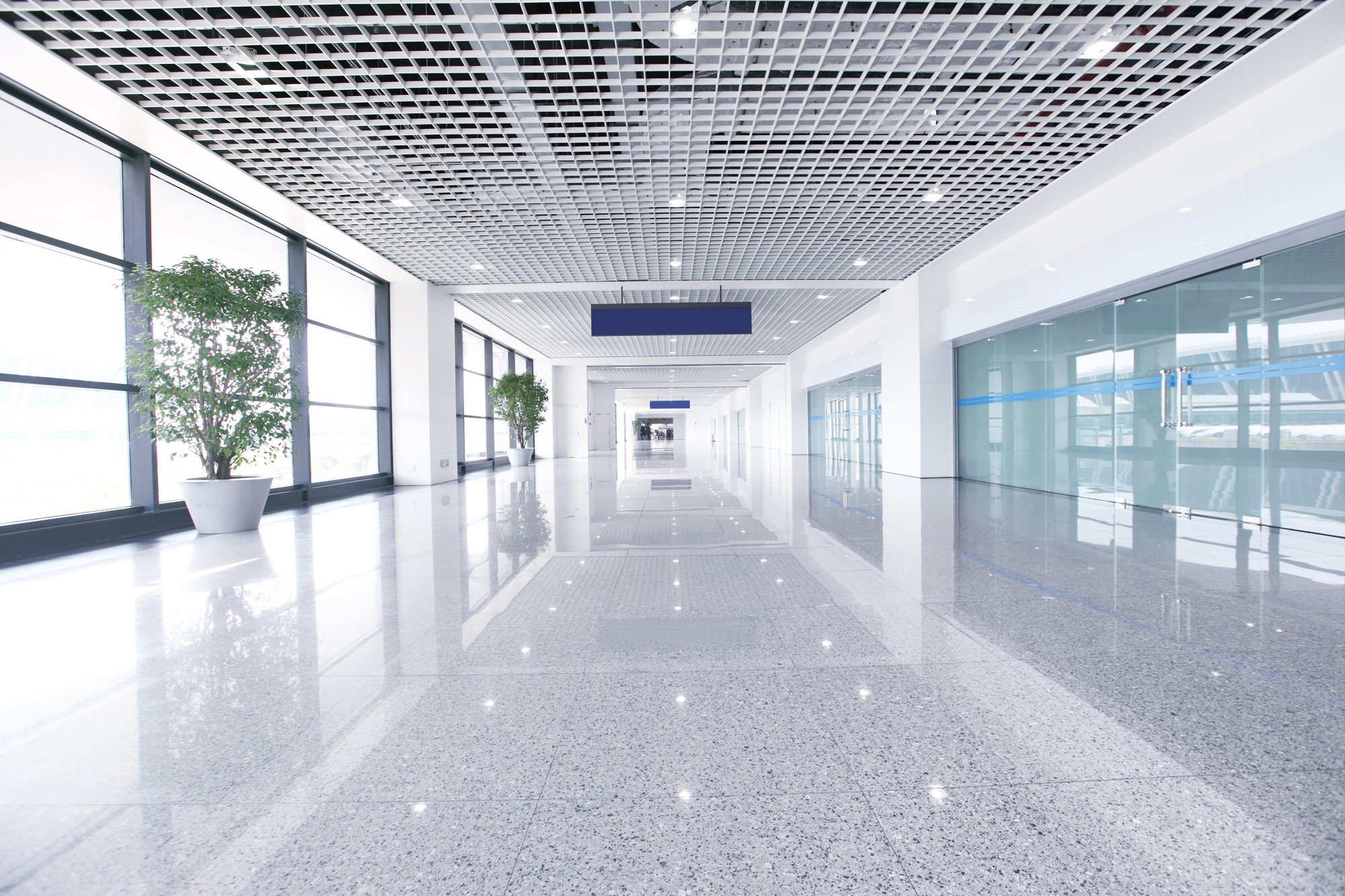 spotless commercial building hallway with shiny marble floors