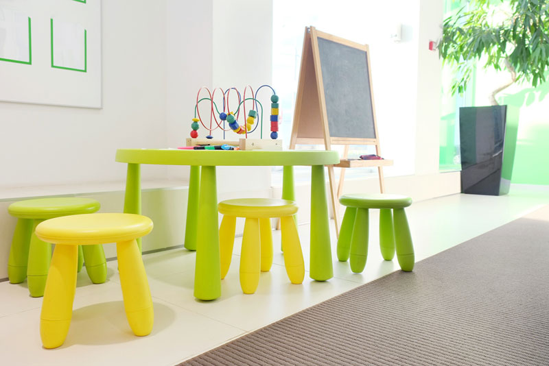 yellow and green table and chair set with chalkboard and toy