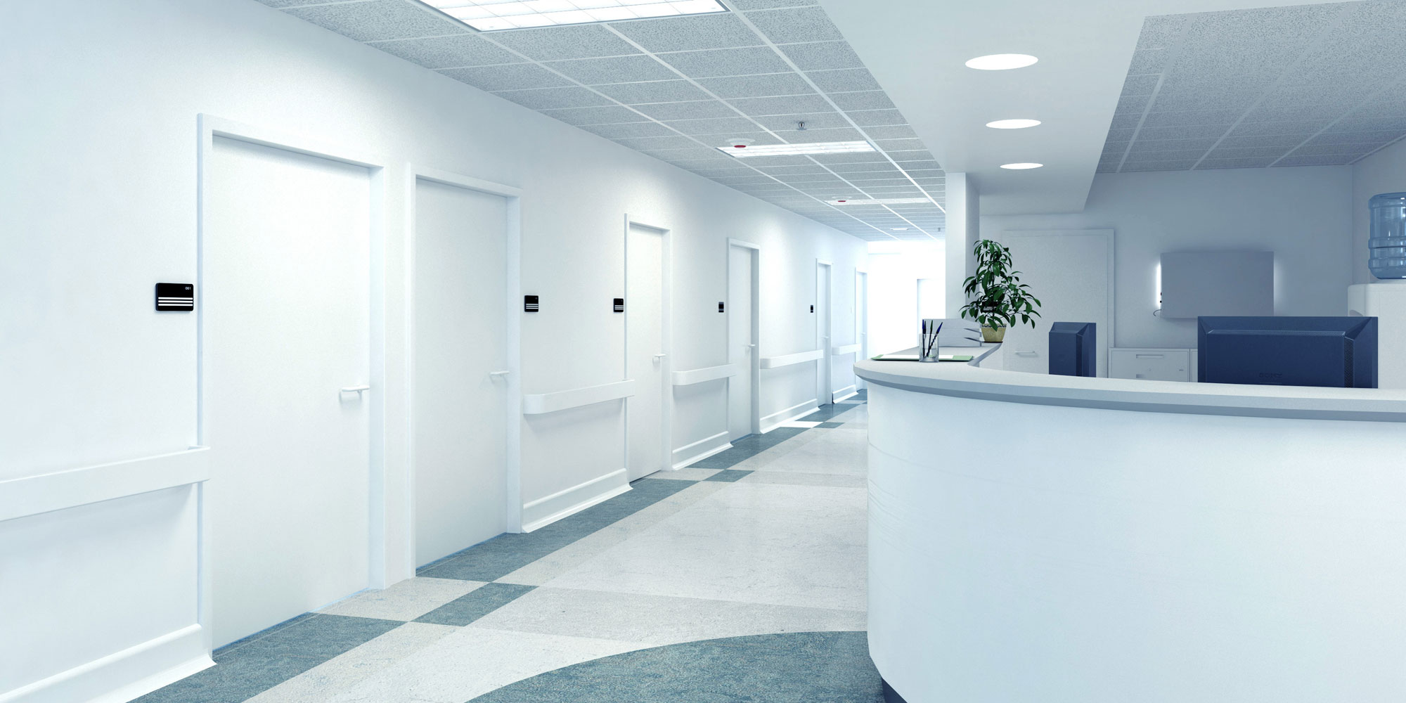 white commercial medical office reception area with geometric floor design